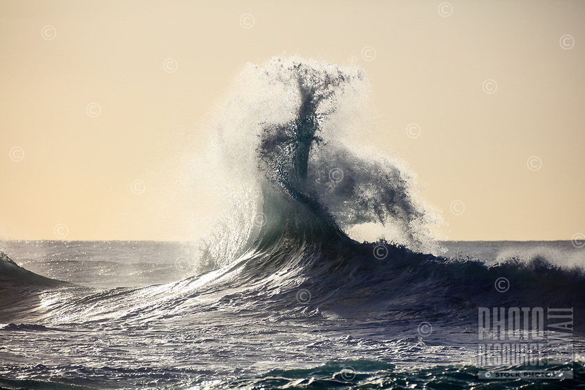 A dynamic meeting of tidal forces create an incredible wave form at Ke'e Beach, Kaua'i.