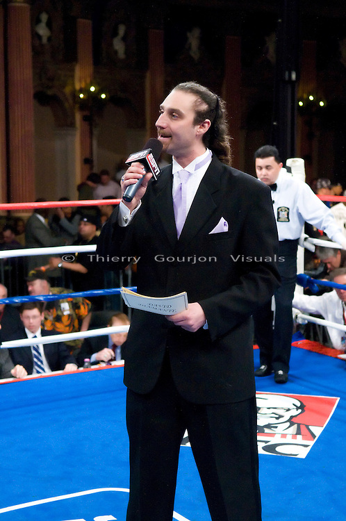 """Bronx, New York - 04.25.08: Boxing ring announcer  David Diamante in the ring before the start of the ESPN's """"Friday Night Fight"""" telecast of the Andrey Tsurkan vs Jesse Felicianno fight."""