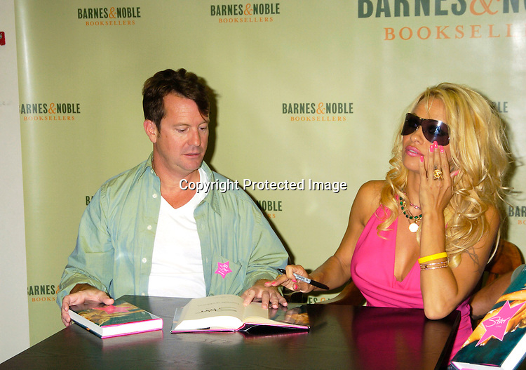 "Ghostwriter Eric Shaw and Pamela Anderson..at a booksigning for Pamela Anderson's new novel  ""Star"" ..on August 2,  2004 at Barnes and Nobles in New York City. ..Photo by Robin Platzer, Twin Images"