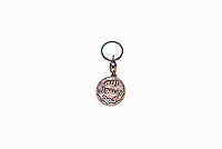 A keyring with the seal of the prophet, the iconography used by the Islamic State Group, is one of a number of items of clothing and objects found in an Islamic clothing and accessory shop in the Bagicilar district of Istanbul.