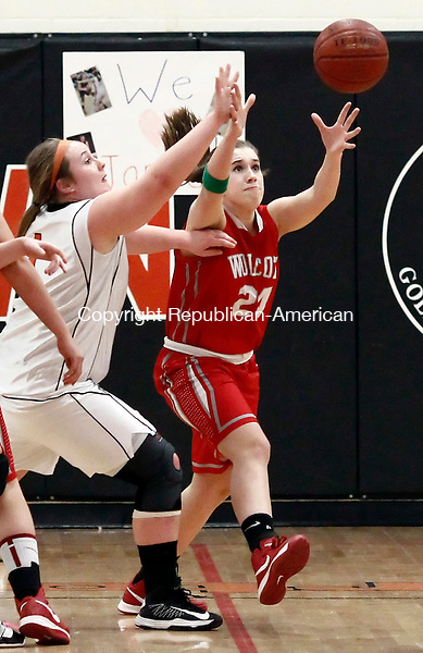 Watertown, CT- 14 February 2013-021413CM02- Watertown's Sara Selimovski, left, and Wolcott's Madison Hanlon go for the ball during their NVL matchup Thursday night in Watertown.   Christopher Massa Republican-American