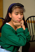 17 year old Vietnamese American woman deep in thought.  St Paul Minnesota USA