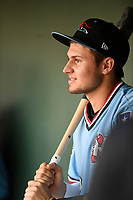 Second baseman Kole Enright (22) of the Hickory Crawdads waits in the dugout before a game against the Greenville Drive on Monday, August 20, 2018, at Fluor Field at the West End in Greenville, South Carolina. Hickory won, 11-2. (Tom Priddy/Four Seam Images)