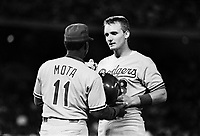 Jeff Hamilton and Manny Mota of the Los Angeles Dodgers during a 1989 pre season game at Anaheim  Stadium in Anaheim,California.(Larry Goren/Four Seam Images)