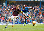 Christophe Berra drags the shirt from Alfredo Morelos