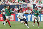 24 June 2007:  USA's Pablo Mastroeni (4) plays between Mexico's Jared Borgetti (9) and Pavel Pardo (8). The United States Men's National Team defeated the national team of Mexico 2-1 in the CONCACAF Gold Cup Final at Soldier Field in Chicago, Illinois.