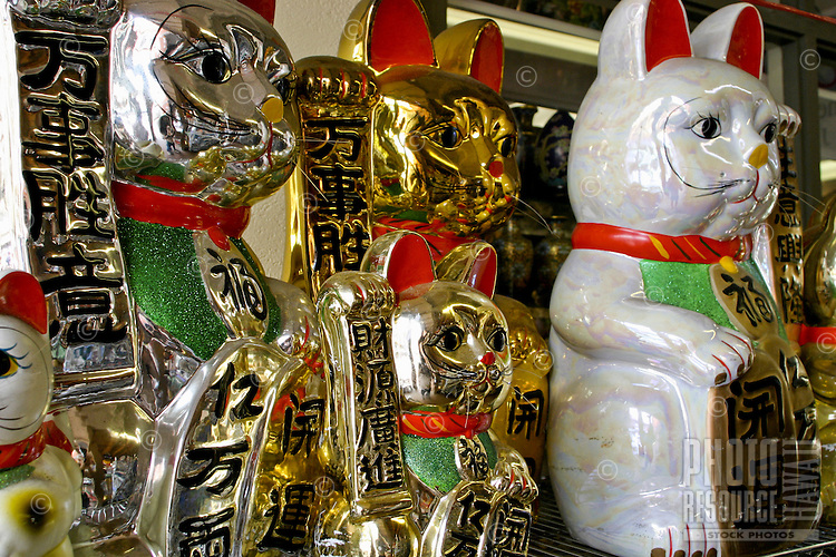 Ceramic figures of cats, pigs and monkeys are signs of good luck in the chinese culture and are available to shoppers in Chinatown, downtown Honolulu, Oahu. Many of the figures serve as coin banks.
