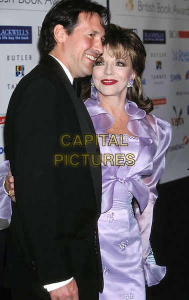 PERCY GIBSON & JOAN COLLINS   ..British Book Awards ..Ref: 11528..half length, half-length, purple silk dress, satin, red lipstick, face lift..www.capitalpictures.com..sales@capitalpictures.com..©Capital Pictures..