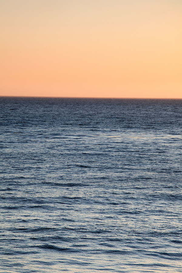 Sunset over the deep blue Pacific Ocean in Malibu, California, USA