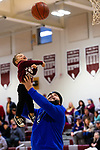 NAUGATUCK,  CT-011820JS14- Ervis Kambo of Waterbury, lifts up Carson Woodall, 2, the son of a friends, as he puts up a shot while they play on the court during half-time of Naugatuck's girls basketball game against Shepaug Saturday at Naugatuck High School. <br /> Jim Shannon Republican-American
