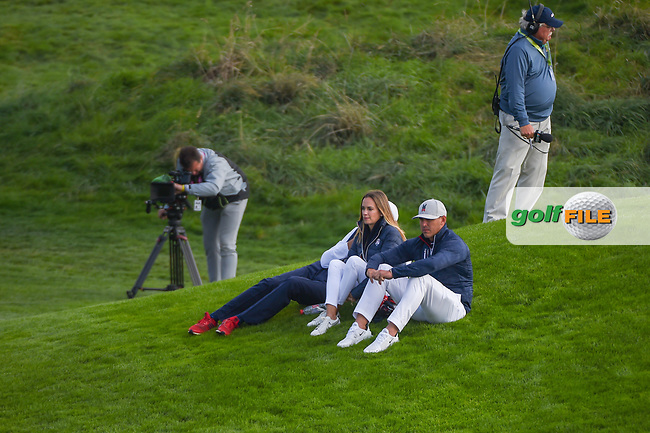 Brooks Koepka (Team USA) and his fiance, Jena Sims watch the afternoon foursomes near the green on 9 during Friday's foursomes of the 2018 Ryder Cup, Le Golf National, Guyancourt, France. 9/28/2018.<br /> Picture: Golffile   Ken Murray<br /> <br /> <br /> All photo usage must carry mandatory copyright credit (© Golffile   Ken Murray)