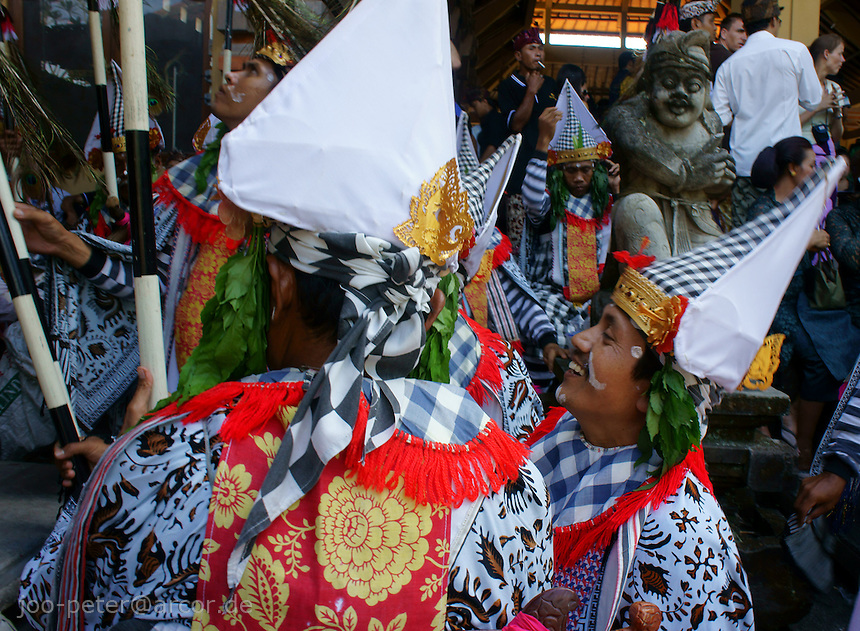 men in traditional costumes with kris as part of procession to cremation place,  cremation ceremonies for of a royal family member, August 2011, Ubud, Bali, archipelago Indonesia