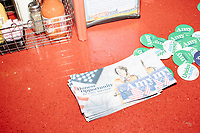 Campaign materials for Democratic presidential candidate and Minnesota senator Amy Klobuchar are seen on the counter at the Red Arrow Diner during a campaign stop in Manchester, New Hampshire, on Wed., October 16, 2019. The event was part of a 10-county tour of New Hampshire and started the day after the 4th Democratic debate, in which analysts said Klobuchar performed well. <br />  The Red Arrow Diner has been a frequent stop for presidential candidates in New Hampshire for decades.