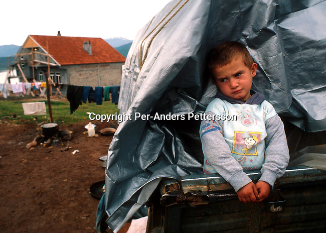 An ethnic Albanian refugees boy from Kosovo in a camp on April 4, 1999 in Kukes, Albania. Hundreds of thousands of people fled into Macedonia and Albania during the Serb terror of Kosovo..Photo: Per-Anders Pettersson/ iAfrika Photos