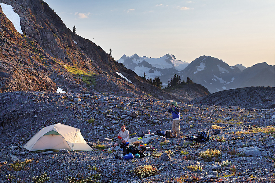 Backpackers tent camping in upper Ferry Basin, Bailey Range Traverse, Olympic National Park, Washington