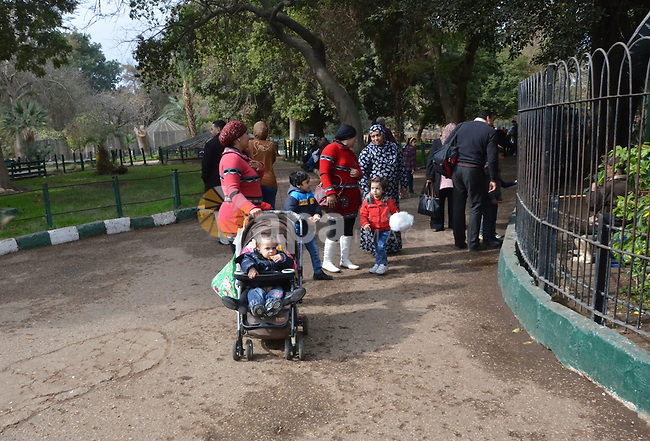 Egyptians enjoy at a zoo in a holiday, in Cairo, Egypt, on January 7, 2016. Photo by Amr Sayed