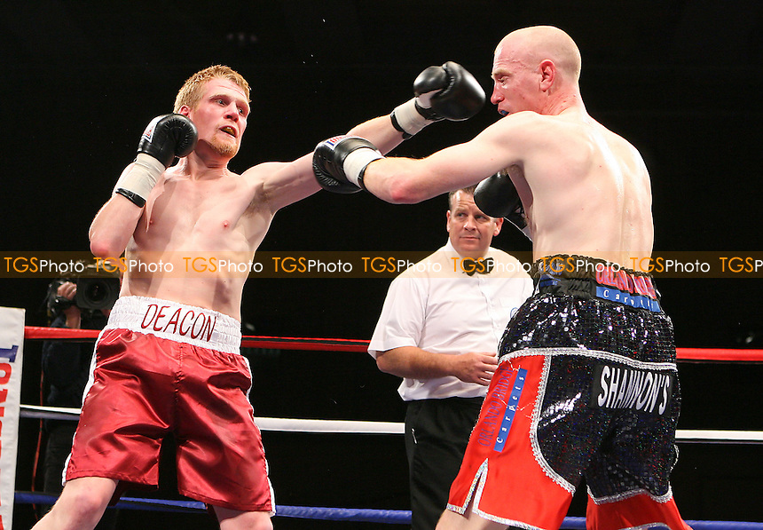 Jonny Rocco (black shorts) defeats Gavin Deacon in a Light-Welterweight Boxing contest at the Kingsway Leisure Centre, Widnes, promoted by Matchroom Sports - 07/05/10 - MANDATORY CREDIT: Chris Royle/TGSPHOTO - Self billing applies where appropriate - Tel: 0845 094 6026.
