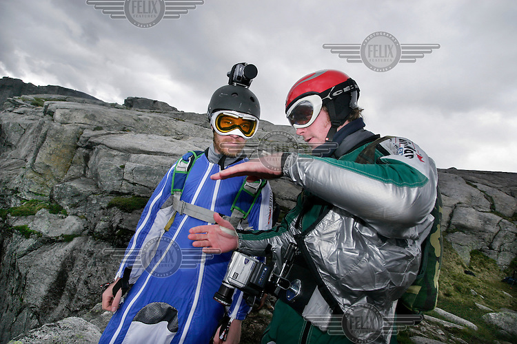 "Hans Holmefjord and Espen Fadnes discuss their upcoming flight from a mountain top. Kjerag in the Lysebotn fjord is popular with BASEjumpers, but considered fairly unchallanging by the wingsuit flyers of ""Verdal'n BASE and Karsk"". © Fredrik Naumann"