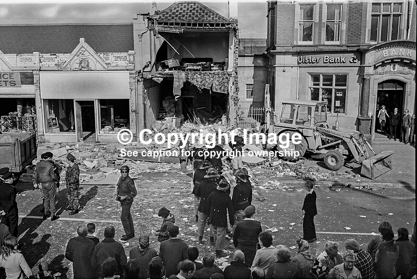 Scene of 3 Oct 1975 explosion at business premises on the Albertbridge Road, Belfast, N Ireland, UK, owned by John McKeague, a prominent loyalist activist. A 57 year old Roman Catholic mother of eight, Mrs Alice McGuinness, died in the blast. Ironically Mrs McGuinness, of Bryson Street, in the nearby staunchly republican Short Strand area was a shopper at Mr McKeague's printing and stationery business. Mr McKeague's sister, Mrs Jean Moore, was injured in the explosion. Mr McKeague's mother, Isabella McKeague, died in a fire that followed an attack four years earlier on the same premises. 197510030002.<br /> <br /> Copyright Image from Victor Patterson, 54 Dorchester Park, Belfast, UK, BT9 6RJ<br /> <br /> t1: +44 28 9066 1296 (from Rep of Ireland 048 9066 1296)<br /> t2: +44 28 9002 2446 (from Rep of Ireland 048 9002 2446)<br /> m: +44 7802 353836<br /> <br /> e1: victorpatterson@me.com<br /> e2: victorpatterson@gmail.com<br /> <br /> The use of any of my copyright images is subject to my Terms &amp; Conditions. It is IMPORTANT that you familiarise yourself with them. They are available at my website, victorpatterson.com.<br /> <br /> None of my copyright images may be used on the Internet unless they are visibly watermarked, i.e. &copy; Victor Patterson within the body of the image. My metadata, denoting my copyright must NOT be deleted. <br /> <br /> Web use is extra at currently recommended NUJ rates. Maximum permitted web size is<br />  400kb. <br /> <br /> Images must not be passed on to a third party - they are for the use of the authorised recipient only.