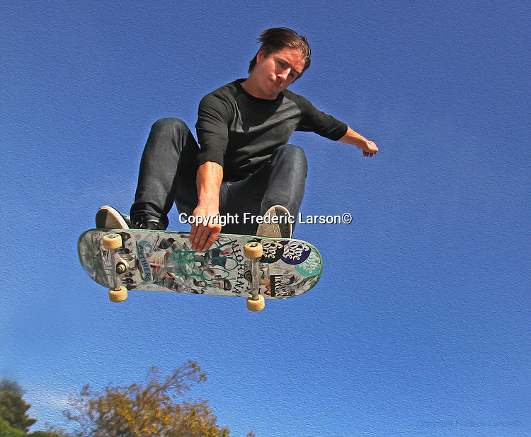 Chase gets some air while skateboarding at San Francisco Portreo del Sol/La Raza Skatepark.