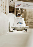 8 January 2016: Alexey Stulnev, piloting his 2-man bobsled for Russia, enters the Chicane straightaway on his first run, ending the day with a combined 2-run time of 1:51.81 and earning a 14th place finish at the BMW IBSF World Cup Championships at the Olympic Sports Track in Lake Placid, New York, USA. Mandatory Credit: Ed Wolfstein Photo *** RAW (NEF) Image File Available ***