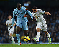 Picture by Howard Roe/AHPIX.com. Football, Barclays Premier League; <br /> Manchester City v Swansea City ;22/11/2014 KO 3.00 pm <br /> Etihad Stadium;<br /> copyright picture;Howard Roe;07973 739229<br /> Swansea's   Jefferson Monterotussles with Manchester's Yaya Toure