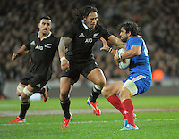 Ma'a Nonu tries to tackle Yoann Huget during the international rugby match between the New Zealand All Blacks and France at Eden Park, Auckland, New Zealand on Saturday, 8 June 2013. Photo: Dave Lintott / lintottphoto.co.nz
