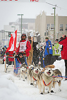 Hank Debruin leaves the 2011 Iditarod ceremonial start line in downtown Anchorage, during the 2012 Iditarod..Jim R. Kohl/Iditarodphotos.com