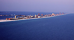 An aerial view of Pensacola Beach from out over the Gulf of Mexico.