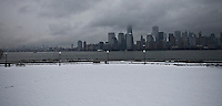 The New York skyline is seen from Weehawken during the season's first snow storm on December 10, 2013 in New York City Photo by Kena Betancur / VIEWpress.