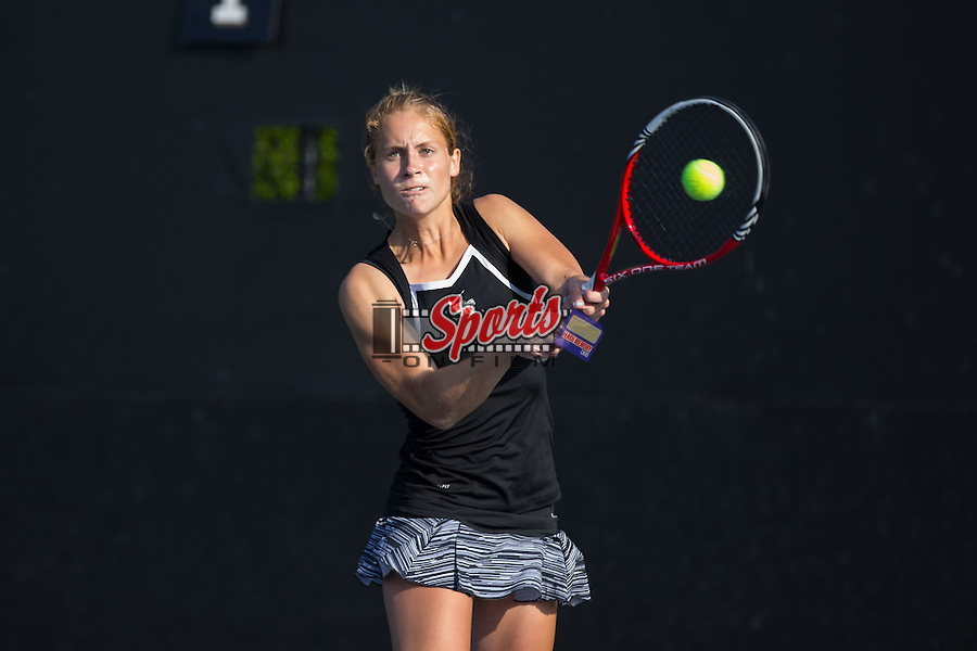 Kimmy Guerin of the Wake Forest Demon Deacons returns the ball during the Wake Forest Invitational at the Wake Forest Tennis Center on October 3, 2014 in Winston-Salem, North Carolina.    (Brian Westerholt/Sports On Film)