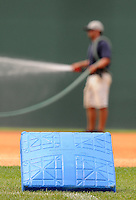 """The bases were painted blue for colon cancer awareness Sunday at Fluor Field at the West End for the """"Drive Out Colon Cancer"""" Greenville Drive game sponsored by BlueCross BlueShield of South Carolina. The Drive lost to intrastate rival Charleston RiverDogs, 7-5. (Tom Priddy/Four Seam Images)"""