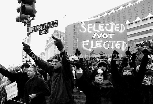 Washington DC, USA<br /> January 20, 2001<br /> <br /> Protesters demonstrate against the inauguration of US President George W. Bush at Freedom Square as the Bush's motorcade passes down Pennsylvania Avenue.