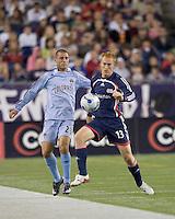 New England Revolution midfielder Jeff Larentowicz (13) controls the ball as Colorado Rapids midfielder Colin Clark (23) defends. The New England Revolution defeated the Colorado Rapids, 1-0, at Gillette Stadium in Foxboro, MA on September 29, 2007.