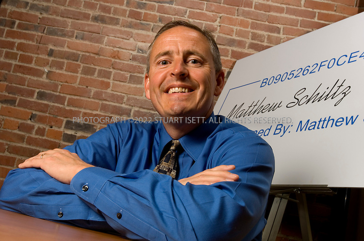 6/5/2007--Seattle, WA, USA..Matthew Schlitz , CEO of DocuSign, an online digital signature provider. behind is a large copy of his digital signature...Photograph ©2007 Stuart Isett.All rights reserved