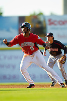 Jordan Akins (5) of the Hickory Crawdads takes his lead off of second base against the Kannapolis Intimidators at L.P. Frans Stadium on May 25, 2013 in Hickory, North Carolina.  The Crawdads defeated the Intimidators 14-3.  (Brian Westerholt/Four Seam Images)