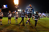 Matt Garvey, mascots in hand, leads the Bath Rugby team onto the field for the start of the match. Aviva Premiership match, between Bath Rugby and Exeter Chiefs on March 23, 2018 at the Recreation Ground in Bath, England. Photo by: Patrick Khachfe / Onside Images