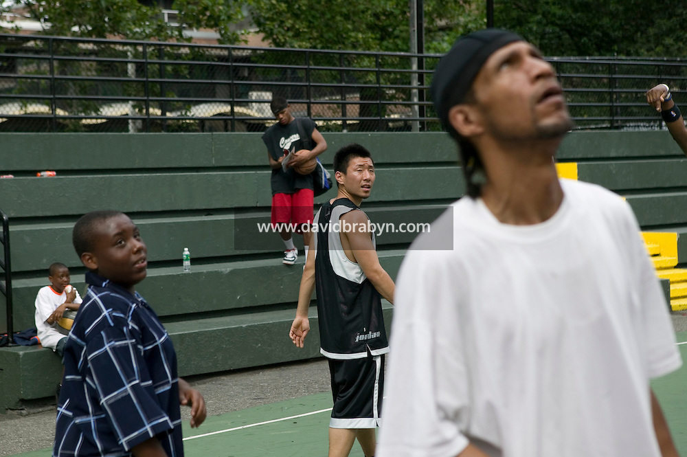 The Far East Ballers, a Japanese street basketball team, play a practice game against a local team at the Rucker Park court in Harlem, New York City, USA, home of the world famous EBC streetball tournament Sunday June 12 2005.