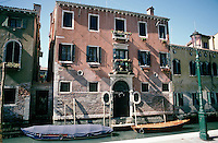 A house on a quiet side canal in Venice.
