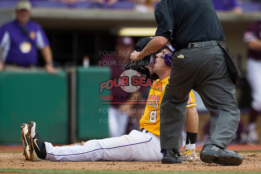 LSU Tigers shortstop Alex Bregman (8) reacts to the umpire's call during a play at home in the Southeastern Conference baseball game against the Texas A&M Aggies on April 25, 2015 at Alex Box Stadium in Baton Rouge, Louisiana. Texas A&M defeated LSU 6-2. (Andrew Woolley/Four Seam Images)