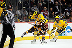 09 APR 2011: Mike Connely (22) of University of Minnesota, Duluth and Chris Brown (10) of the University of Michigan battle for the Puck during the Division I Men's Ice Hockey Championship held at the Xcel Energy Center in St. Paul, MN.  Minnesota-Duluth beat Michigan in overtime, 3-2 to claim the national title. Vince Muzik/NCAA Photos
