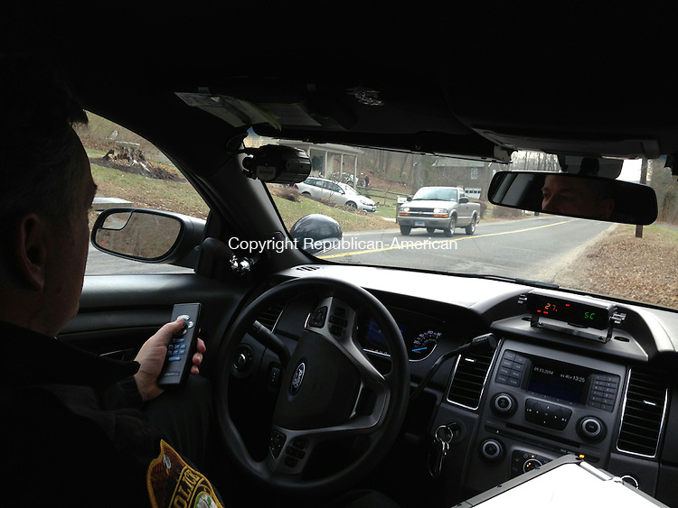 WOODBURY, CT - 13 Jan 2014 - 011314RH01 - Woodbury Police Officer Tim Wright operates an onboard radar detector on Mountain Road in Woodbury. Residents on the street have complained of speeding vehicles. Rick Harrison Republican-American