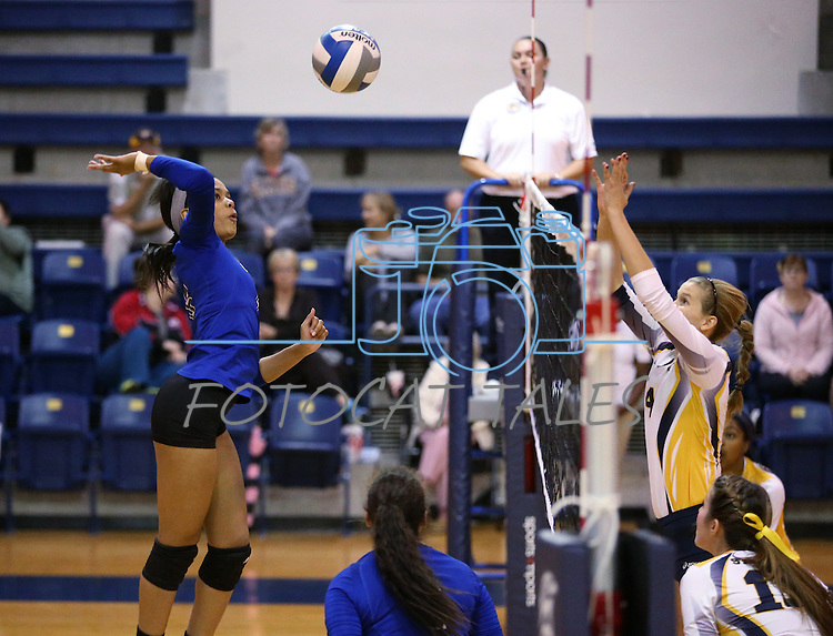 Marymount's Cailyn Thomas hits in a college volleyball game against St. Mary's in Lexington Park, MD, on Wednesday, Oct. 29, 2014. Marymount won 3-2 to go 24-9 on the season.<br /> Photo by Cathleen Allison