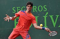 BOGOTA - COLOMBIA -09 -11-2013: Thomaz Bellucci, tenista de Brasil, devuelve la bola a Alejandro Falla, tenista de Colombia, durante partido de semifinales del Seguros Bolivar Open en el Club Campestre el Rancho de la ciudad de Bogota. / Thomaz Bellucci, Brazil tennis player returns the ball to Alejandro Falla, Colombia tennis player during a match for the semifinals of the Seguros Bolivar Open in the Club Campestre El Rancho in Bogota city. Photo: VizzorImage  / Luis Ramirez / Staff.