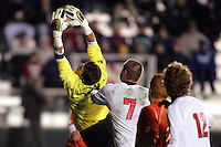 Clemson goalkeeper Phil Marfuggi (right) stretches to make a save on a New Mexico set piece. The University of New Mexico defeated Clemson University 2-1 in the NCAA Semifinal at SAS Stadium in Cary, North Carolina, Friday, December 9, 2005.