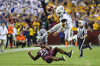 Landover, MD - September 3, 2017: West Virginia Mountaineers quarterback Will Grier (7) hurdles over a West Virginia Mountaineers defender during game between Virginia Tech and WVA at  FedEx Field in Landover, MD.  (Photo by Elliott Brown/Media Images International)