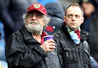 Burnley fans wait for kick-off in heavy rain at Turf Moor<br /> <br /> Photographer Rich Linley/CameraSport<br /> <br /> The Premier League - Burnley v Leicester City - Saturday 16th March 2019 - Turf Moor - Burnley<br /> <br /> World Copyright © 2019 CameraSport. All rights reserved. 43 Linden Ave. Countesthorpe. Leicester. England. LE8 5PG - Tel: +44 (0) 116 277 4147 - admin@camerasport.com - www.camerasport.com
