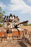 SOUTH SUDAN Rumbek , children on old battle tank from war between SPLA and northern Sudan /Sued Sudan Rumbek , Kinder spielen auf zerstoertem Panzer aus dem Konflikt zwischen SPLA , Suedsudanesische Volksbefreiungsarmee , und dem Nordsudan , der Suedsudan strebt eine Unabhaengigkeit von Khartoum Khartum an