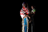 "Ashu Hamar Hussein 22 years old from Jowhar, holds her son Sowzia Abdi Nuur Adahor 2 years old in a tent of the IDP (Internally displaced population ) camp ""Djibouti 2""where she lives  in the war torn Somalia capital Mogadishu on Thursday October the 25th 2007.Ashu left her home town due to the war.///..Since the end of December 2006, when the Ethiopian-backed Somali government forces took over from the Union of Islamic Courts, more than 1,000 people have been killed and 400,000 displaced by violence in Mogadishu..The fragile Somali government has been beset by roadside bombings, assassinations and suicide attacks since it routed Islamic Courts fighters in January with the help of Ethiopian tanks and warplanes.. The new battles come as tensions at the top of the fledgling administration threaten a split..Analysts say tensions between Abdullahi Yusuf, the Somali president, and Ali Mohamed Gedi, the prime minister, have been simmering since they came to power in late 2004. The rift has widened in recent months as each has backed rival concerns hoping to exploit the nation's potential oil resources.."