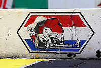 May 30, 2013; Englishtown, NJ, USA: Detailed view of the worn logo for Raceway Park on a wall. Mandatory Credit: Mark J. Rebilas-